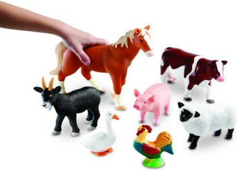 Size of farm animals is clear when compared to child's hand in shot