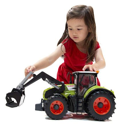 Bruder 03013: Claas Axion 950 Tractor, child playing