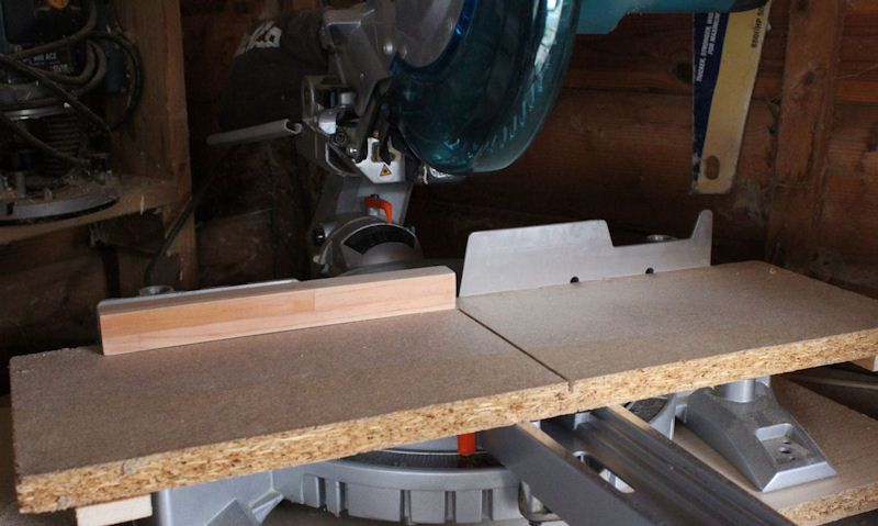 Template fixed to Makita mitre saw in workshop