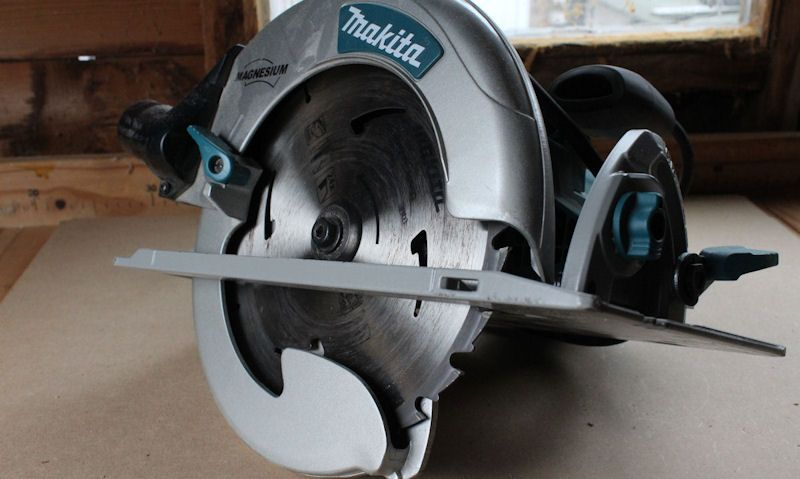 Makita circular saw on woodworking bench